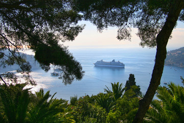 Coastline of the Cote d'azur, with a cruise ship anchored in the bay, Villefranche, France.