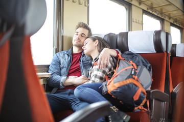 Couple sleeping on a train