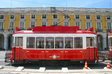 Traditional red tram in Praça do Comércio (or Commerce Square), Lisbon, Portugal.