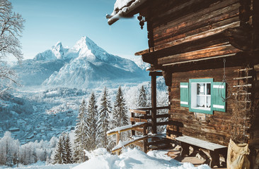Fototapete - Traditional mountain cabin in the Alps in winter