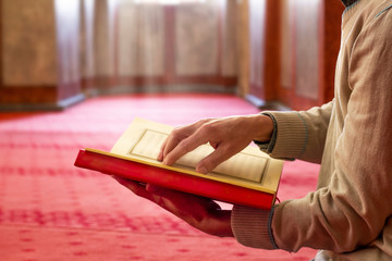 Muslim Man Reading Holy Book (Qur'an) Inside The Mosque