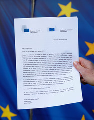 A copy of a joint letter from EU Commission President Juncker and EU Council President Tusk sent to British PM May is displayed with an EU flag in Brussels, in this picture illustration