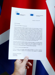 A copy of a joint letter from EU Commission President Juncker and EU Council President Tusk sent to British PM May is displayed with a British Union Jack flag in this picture illustration