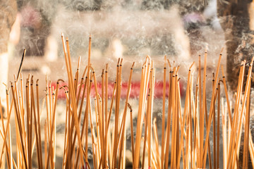 Burning red incense sticks in Chinese temple with letter write in