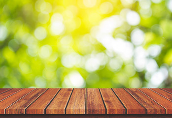 Empty wood table top on green nature background, Template mock up for display of product