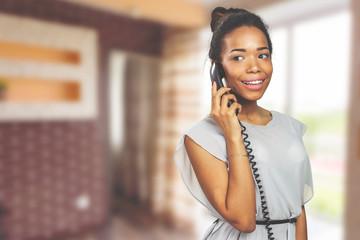 Casual businesswoman using phone