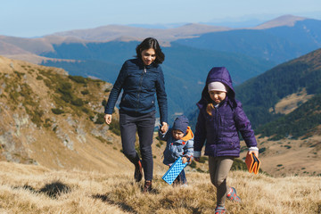 woman walking with son and daughter in transalpina