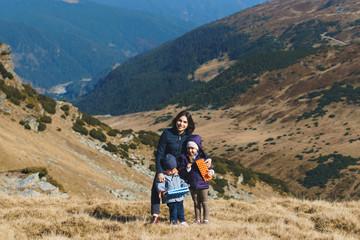 mother hugging children on transalpina hill