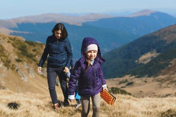 girl and mother with brother walking in transalpina