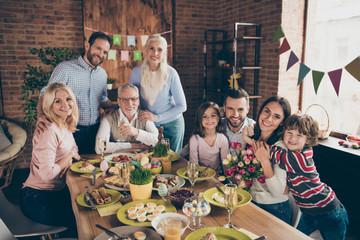 Fototapeta Close up photo of large company gathered family holiday sitting  obraz