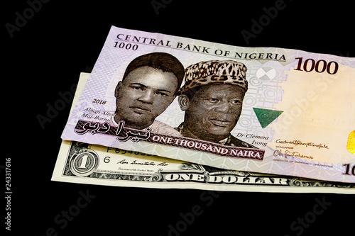 Nigerian Naira Note On A Us Dollar Bill International Trade Globalization