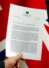 A copy of a letter from British PM May sent to EU Council President Tusk and EU Commission President Juncker is displayed with a British Union Jack flag in Brussels, in this picture illustration