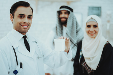 Smiling Arabic Family and Doctor Looking in Camera