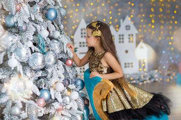 Little girl decorating christmas tree. Christmas. New Year. Christmas eve Indoor Home.