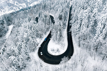 Cars on road in winter conditions severe snowfall weather