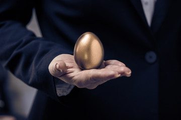 golden egg in female hand