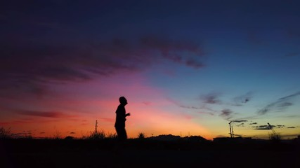 c0dddab3cbd6 0 12 Silhouette of young man jogging in summer sunrise sky outdoor.  Lifestyle healthy concept .