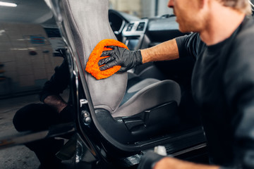 Chemical cleaning of car seats using special agent