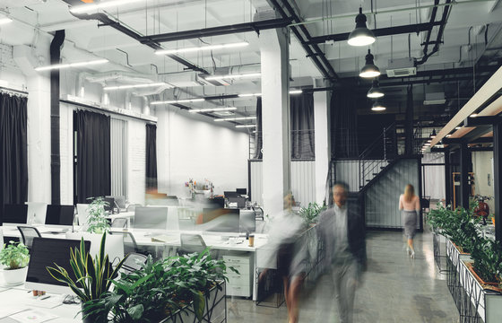 modern office interior with blurred business people in motion