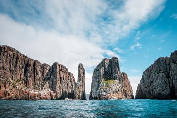 View to the Totem Pole of Cape Hauy, rough coastline with dolerite cliffs, Tasmania, Australia