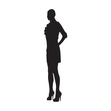 Slim woman with hand on hip standing in high heels shoes, isolated vector silhouette, side view
