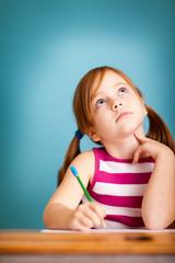 Daydreaming Little Girl in School Desk