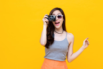 Young female asian traveller taking a picture