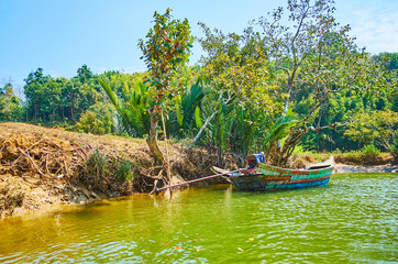 The boat at the Kangy river's bank, Myanmar