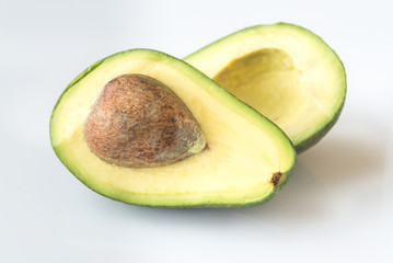 Halved avocado on the white background