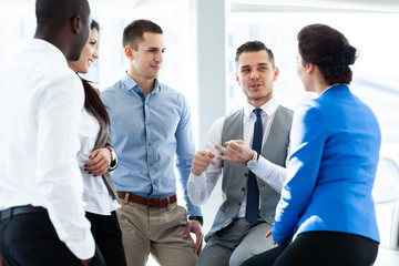 Image of business partners discussing documents and ideas at meeting.