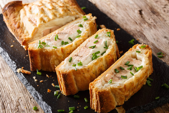 Delicious pie stuffed with salmon and cheese close-up. horizontal