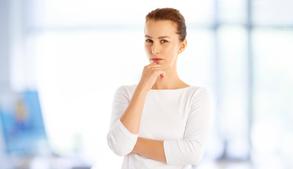 Woman looking thoughtful at office