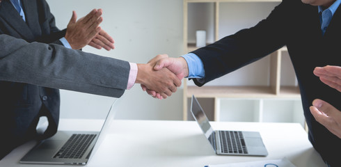 Successful businessmen handshaking good deal after negotiation. Concept of partnership.