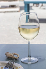 Wine glass with chilled white wine at beach restuarant table at West Coast South Africa