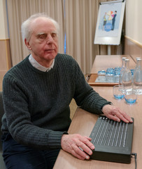A blind man demonstrates the Canute 360, a multi-line braille e-reader developed by Bristol Braille Technologies that the company describes as a 'Kindle for the blind' in Reading