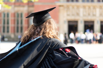 Female graduate from behind at graduation from university