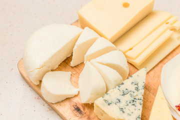 Different kinds of cheeses, with dried meat