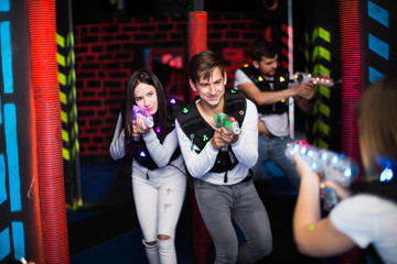 Guy and girl during laser tag game