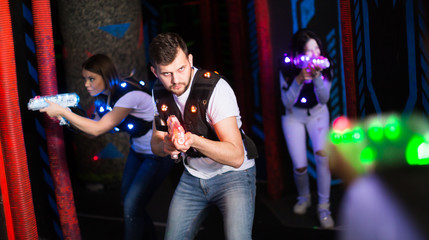 Young man on laser tag arena