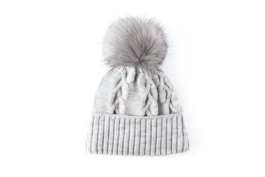 Gray winter knitted hat with boom isolated on white background.