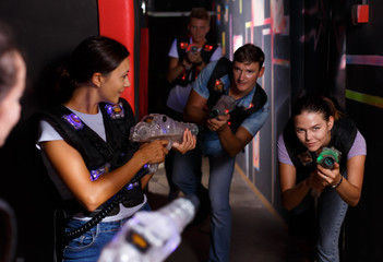 Jolly  young girls took aim with laser guns
