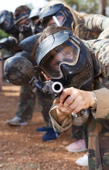 Team playing paintball outdoor