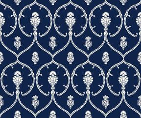 Seamless indigo dye woodblock printed ethnic pattern. Traditional European damask motif with geometric florals, ecru on navy blue background. Textile or wallpaper print.