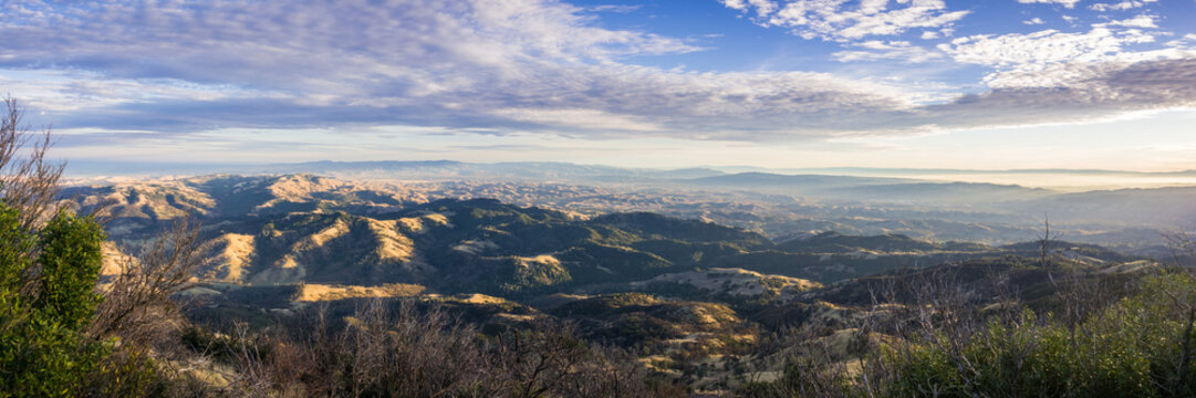 Panoramic view at sunset from the summit of Mt Diablo,  Pleasanton, Livermore and the bay covered in fog in the background, Mt Diablo SP, Contra Costa county, San Francisco bay area, California