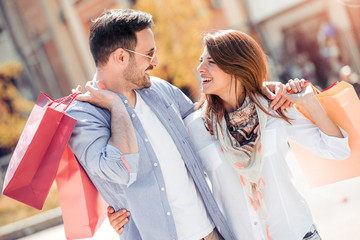 Young couple enjoying shopping in the city