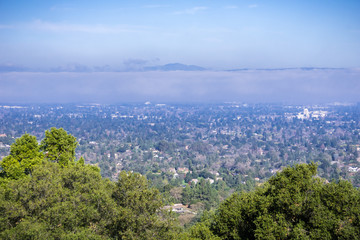Aerial view of Mountain View and Los Altos covered by a layer of fog, San Francisco bay, California