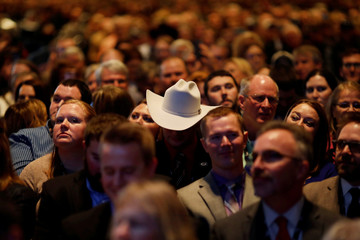 People listen as U.S. President Donald Trump addresses the National Farm Bureau Federation's 100th convention in New Orleans, Louisiana, U.S.
