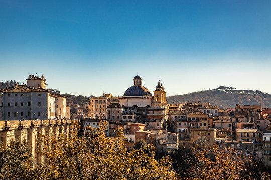 View of Ariccia, with the monumental bridge, the baroque Chigi palace and the church of Santa Maria Assunta by Gian Lorenzo Bernini. Castelli Romani, Lazio, Italy.