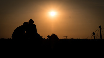 Couple Silhouette at Sunset in Olympiapark Munich