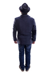 man with hat and jacket stands with his back to the viewer, isolated on white background